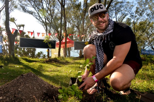 Rubber Duc's lead singer, Nick Jordaan, planting a tree at the festival