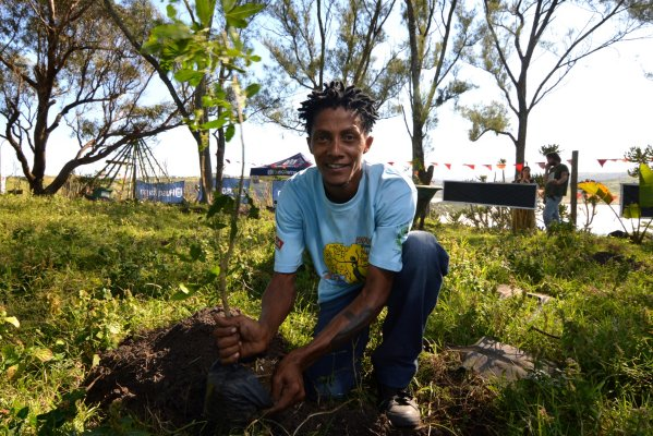 Charles Gxala, Transcape NPO, planting a tree.
